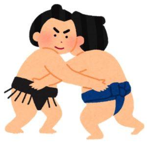 お相撲さんががっぷりよつに組んでいる
